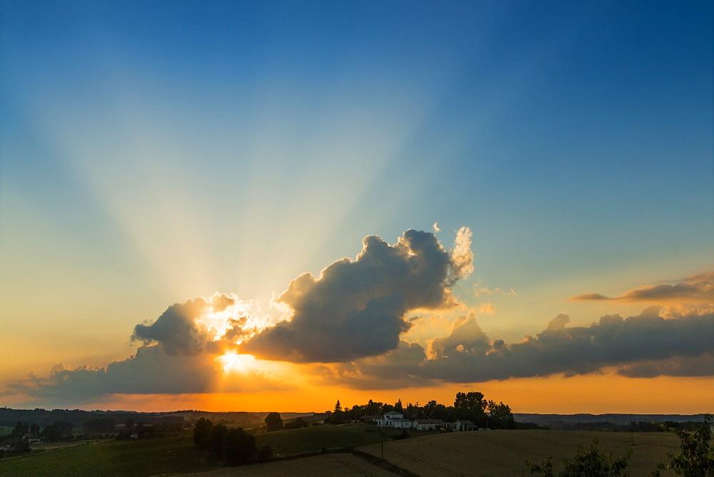 View westwards at sunset from this quiet hilltop village near Duras. Lévignac-de-Guyenne; Lot-et-Garonne; Aquitaine; France