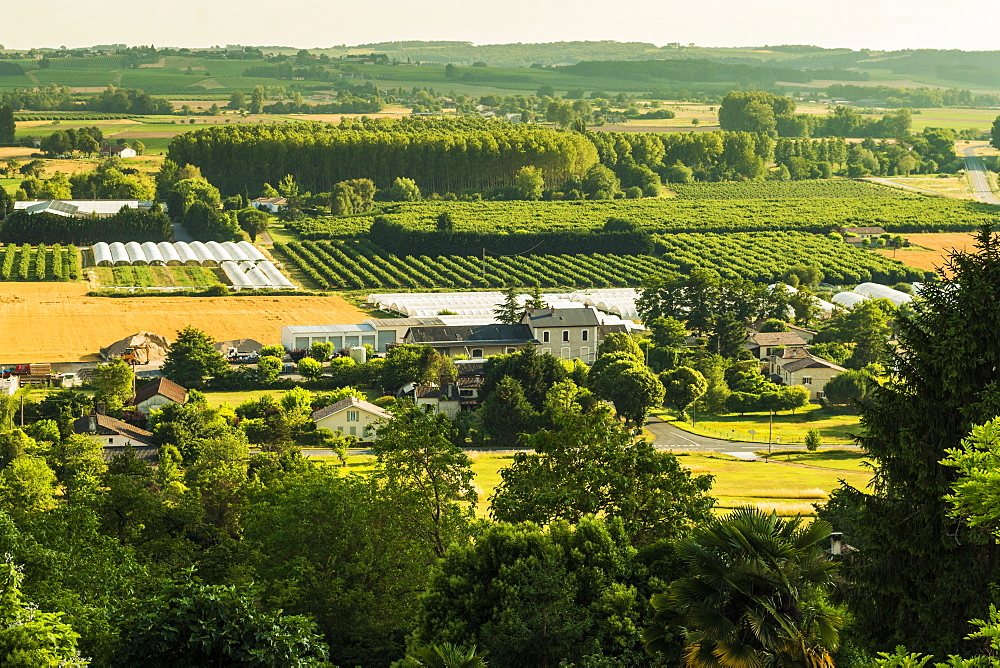 View of fields, orchards & 'polytunnels' in summer seen from this important hilltop town. Duras; Lot-et-Garonne; France