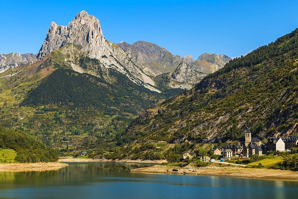 Lanuza lake and village and Pena Foratata peak in the scenic upper Tena Valley, Sallent de Gallego, Pyrenees, Huesca Province, Spain, Europe - 83-13024