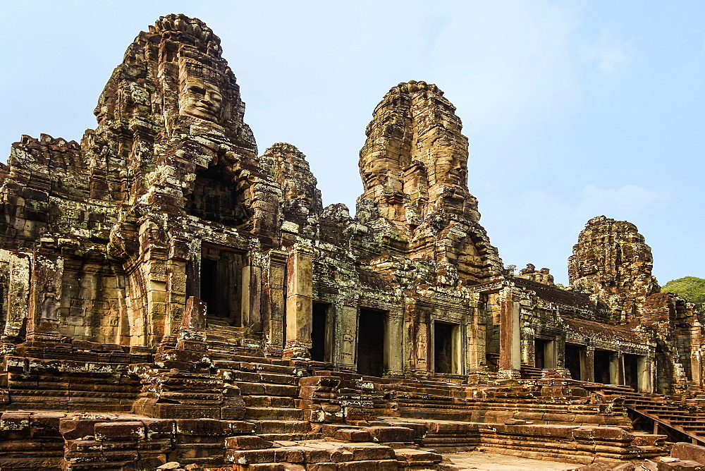 West inner gallery towers and 7 of the 216 carved faces at Bayon temple in Angkor Thom walled city; Angkor, Siem Reap, Cambodia