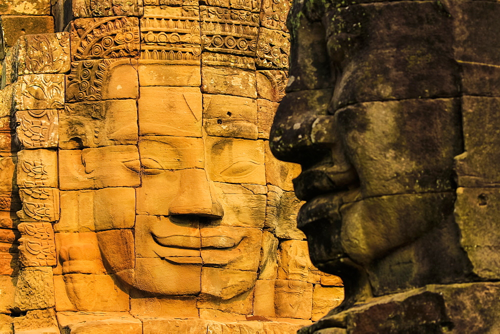 Two of 216 smiling sandstone faces at 12th century Bayon, King Jayavarman VII's last temple in Angkor Thom, Angkor, UNESCO World Heritage Site, Siem Reap, Cambodia, Indochina, Southeast Asia, Asia