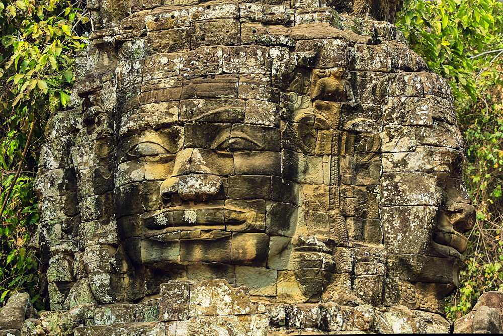 Two of four carved faces on gopura entrance way to the 12th century Banteay Kdei temple in ancient Angkor, Angkor, UNESCO World Heritage Site, Siem Reap, Cambodia, Indochina, Southeast Asia, Asia