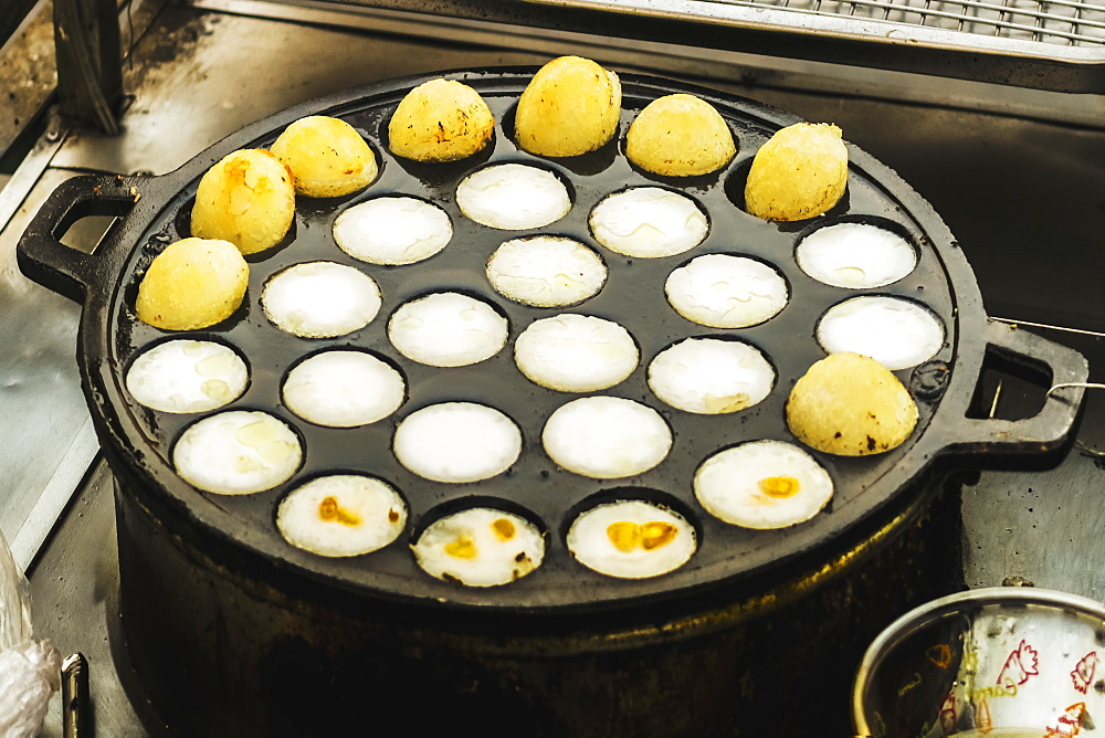 Sticky rice balls cooking in the Psar Chas Old Market in centre of this important north west tourist town, Siem Reap, Cambodia, Indochina, Southeast Asia, Asia