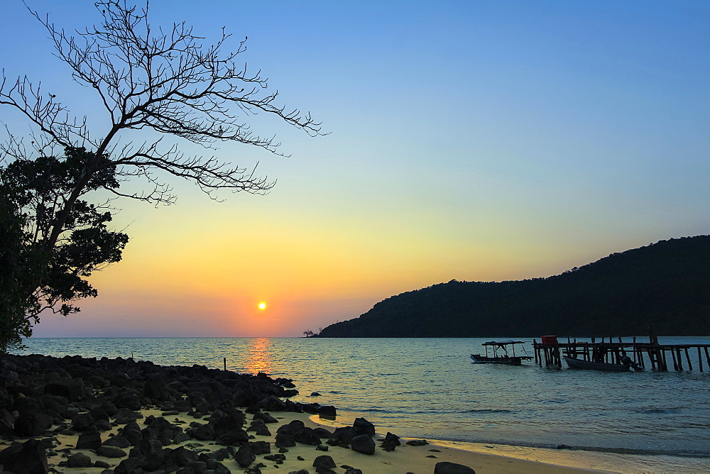 Sunset & pier on the quiet rocky west coast of this holiday island; Lazy Beach, Koh Rong Sanloem Island, Sihanoukville, Cambodia