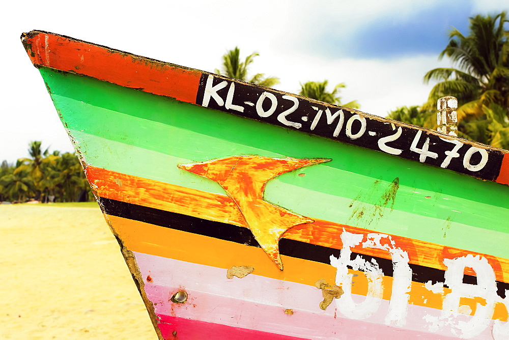 Prow of colourfully decorated fishing boat on popular Marari Beach; Mararikulam, Alappuzha (Alleppey), Kerala, India