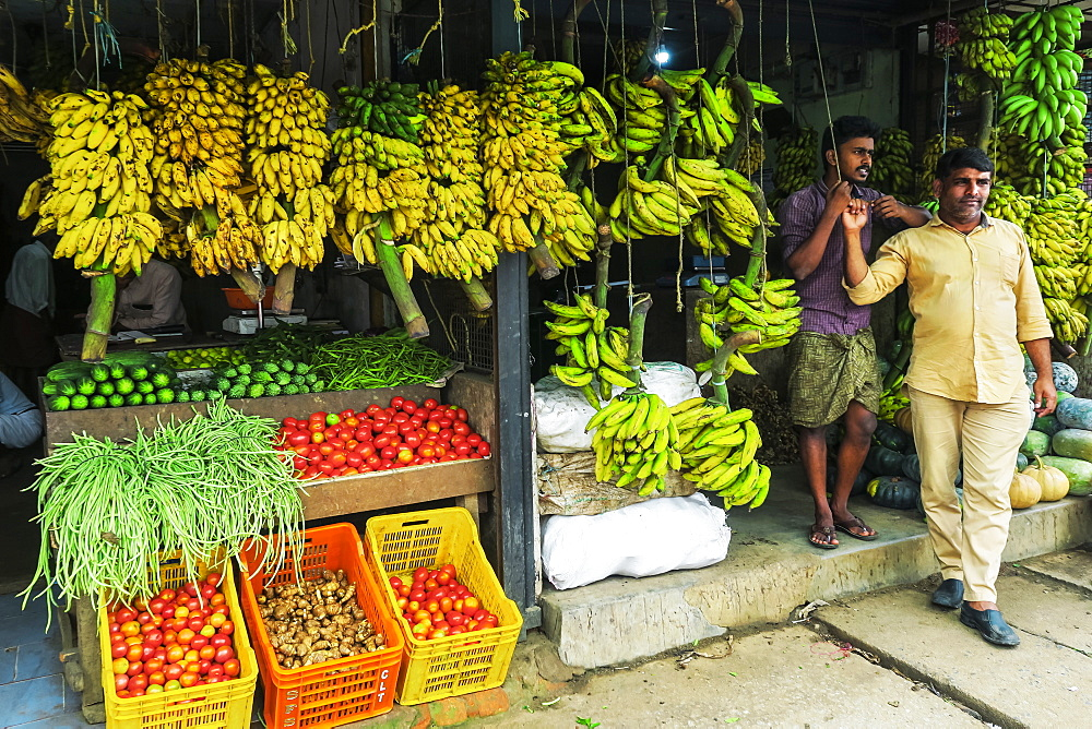 Bananas, beans, tomatoes & others at fruit & veg shop on Main Rd in this Wayanad district town; Kalpetta, Wayanad, Kerala, India