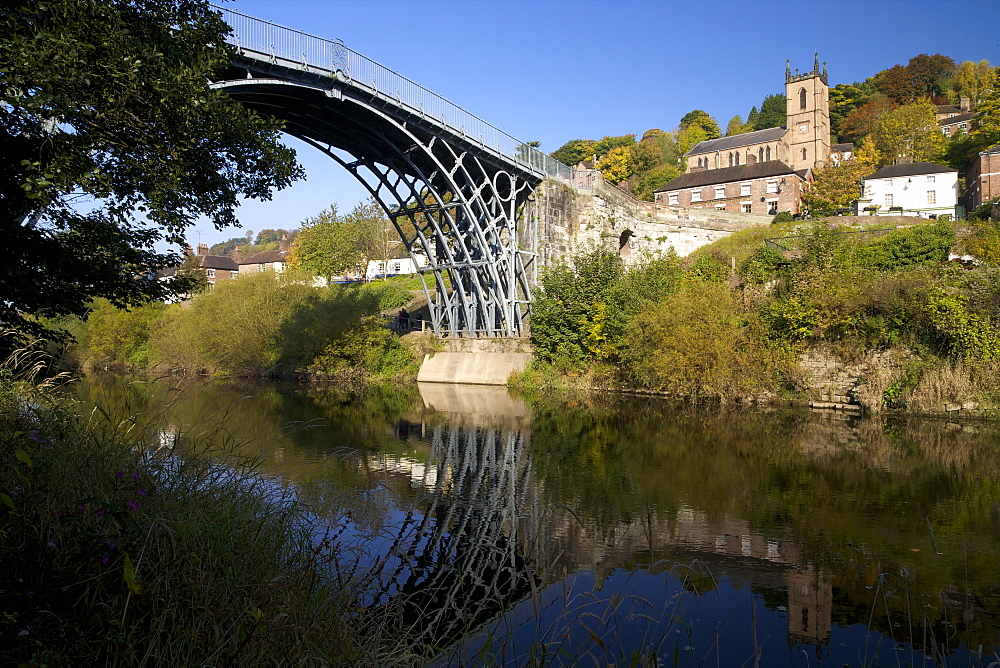 Worlds first iron bridge spans the banks of the River Severn in autumn sunshine, Ironbridge, UNESCO World Heritage Site, Shropshire, England, United Kingdom, Europe