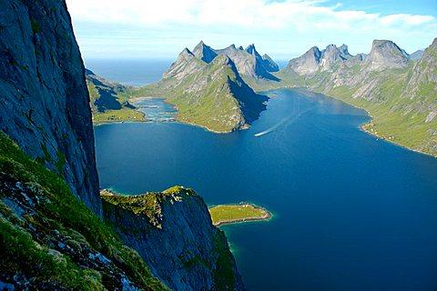 Big rock of Navaren and rough mountains with fjord Kjerkfjorden Moskenesoya Lofoten Norway