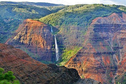 Waipo'o Falls from the steep cliffs of the Waimea Canyon, Kaua'i Island, Hawaii, USA
