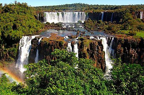 Cascades with rainbow Iguazu Waterfalls Argentina Brazil