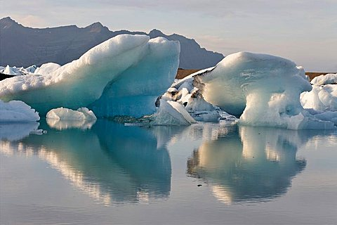 Icebergs, the darker ones coloured by volcanic ash, Joekulsarlon glacial lake, southern coast of Iceland, Atlantic Ocean