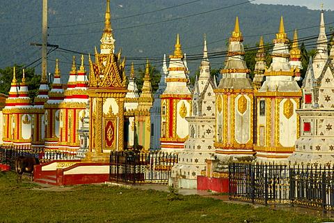 Many colourful stupas monastery Wat Tham Fai Pakse Laos