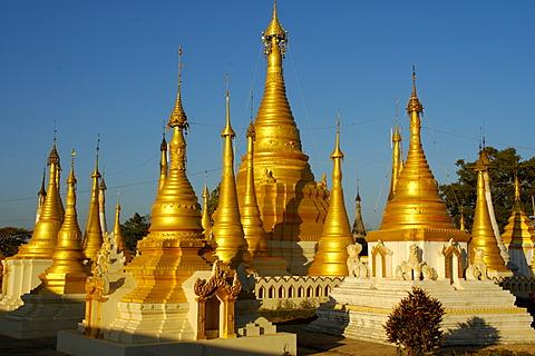 Nin-Ne Temajun Pagoda with golden stupas Pindaya Shan State Burma