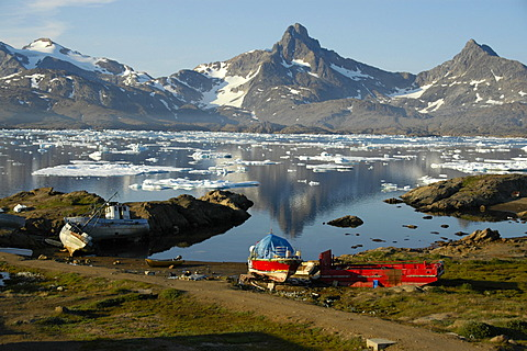 Old colourful boats at the shore Ammassalik Fjord Eastgreenland