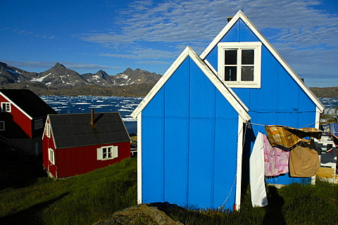 Blue and red wooden house in settlement Ammassalik Eastgreenland