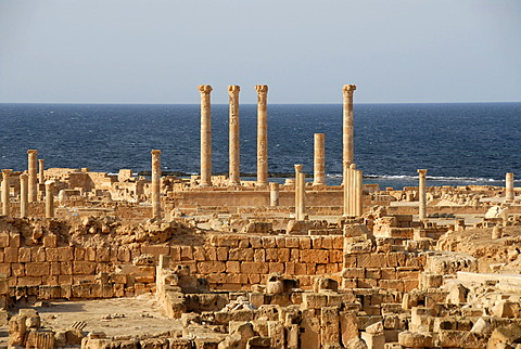 View over excavation site walls and pillars at the sea Sabratha Libya