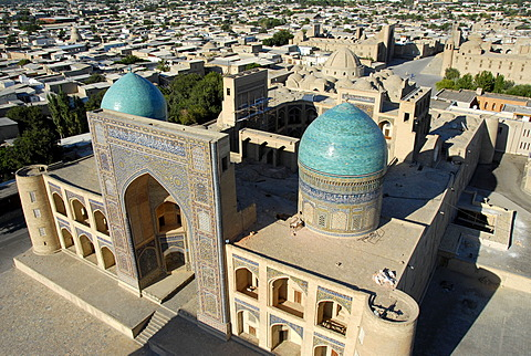 View over the blue cupolas of Mir-i Arab Madrasah and roofs of the city from minaret Kalon Bukhara Uzbekistan