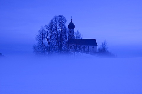 Church with fog in Oberbuchen near Bad Heilbrunn south of Munich Bavaria