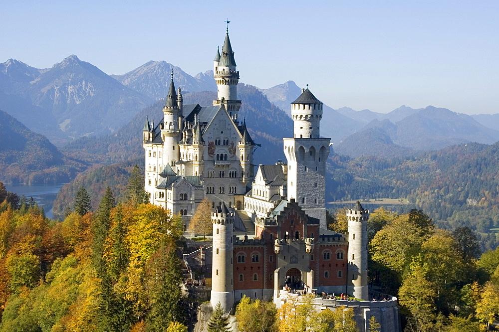 Castle Neuschwanstein near Fuessen Füssen in the Allgaeu Allgäu Bavaria Germany built throug King Ludwig II. with the Lake Alpsee