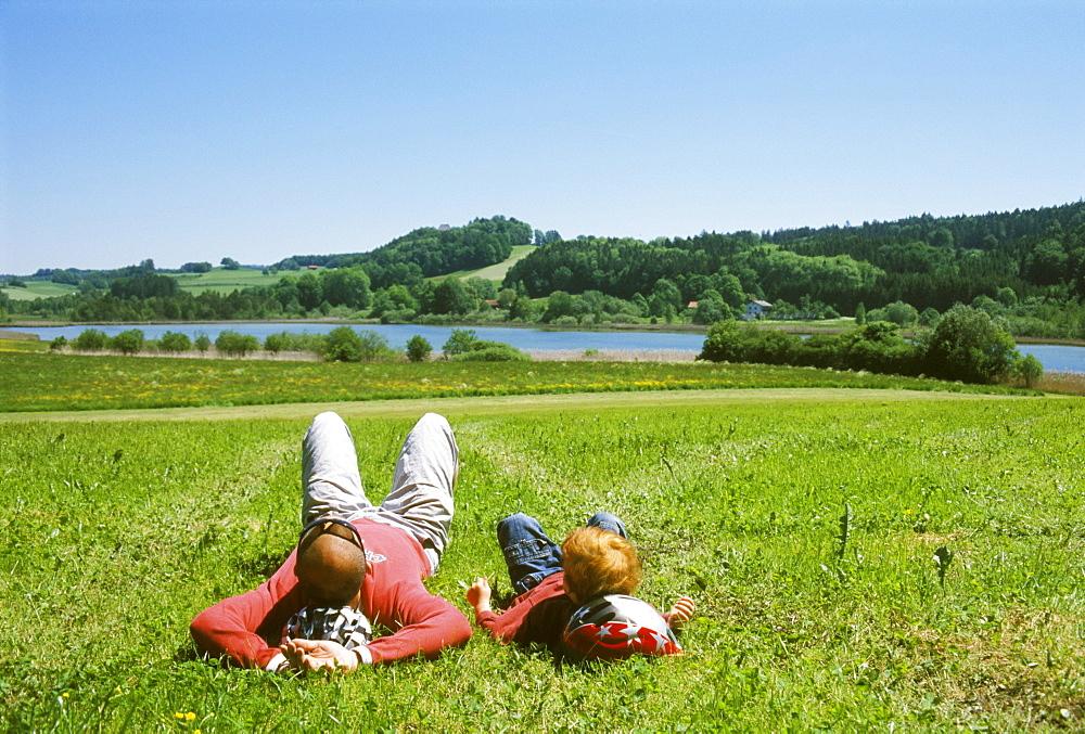 Near Thanning south of Munich Upper Bavaria Germany resting near a lake