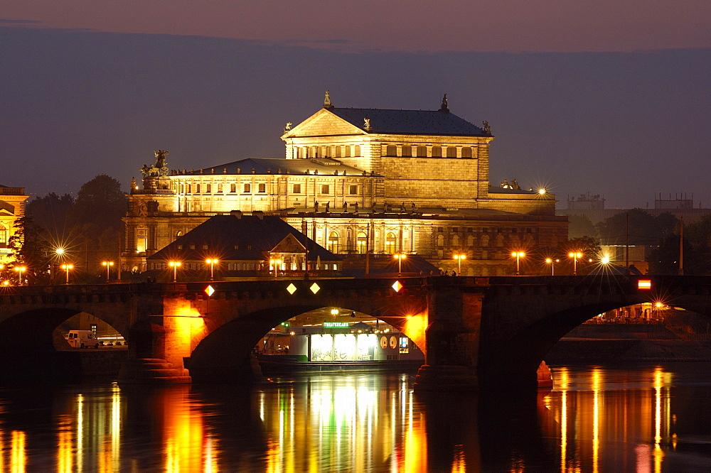 River Elbe Semper opera Augustus bridge historical buildings at twilight Dresden Saxony Germany