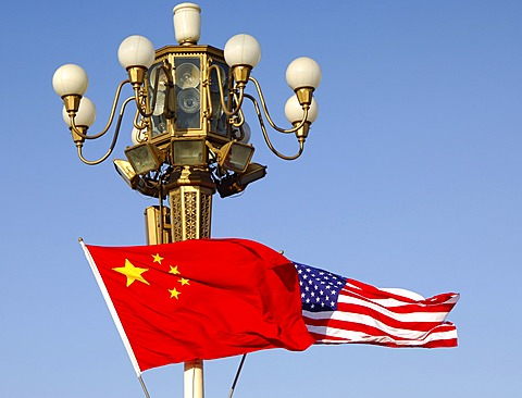 Flags of the People\'s Republic of China and the United States flutter jontly at lamp post of Tiananmen Square, State visit by President Bush, November 2005, Beijing China