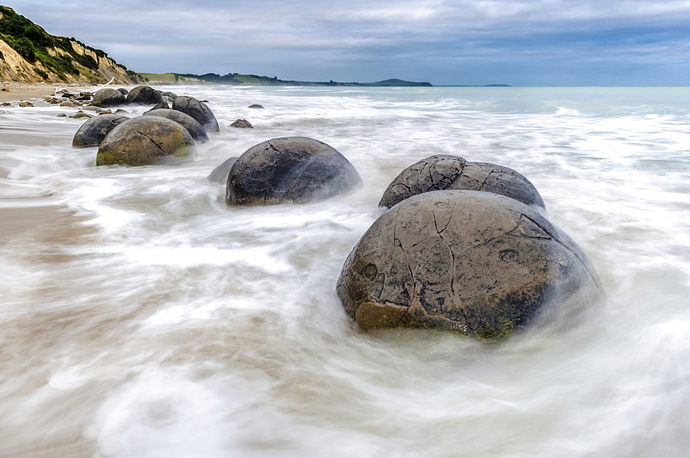 Moeraki Boulders, geological feature, round rock balls, washed by the waves of the surf at high tide, Coastal Otago, Moeraki, South Island, New Zealand, Oceania