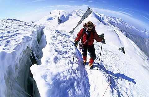 Woman near a crevasse on Allalinhorn Valais Switzerland