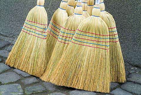 Birch Brooms on a Market