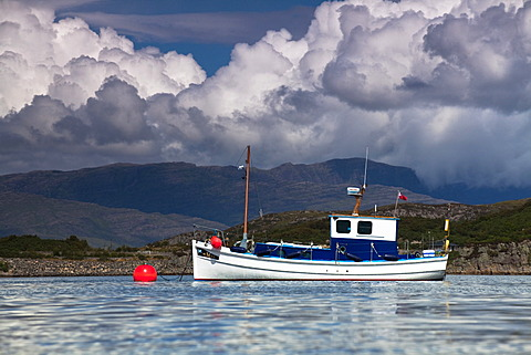 Small boat in the port of Kyleakin on the Isle of Skye, Scotland, United Kingdom, Europe