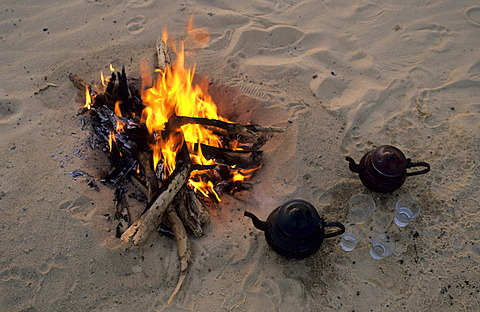 Arabian tea pot near campfire, Libya