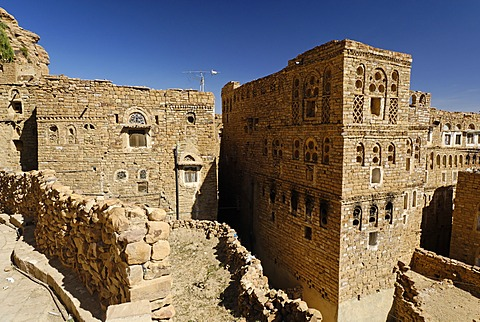 Decorated stone houses in the old town of Thula, Yemen