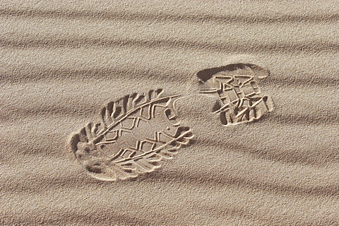 1 one footprint in sand