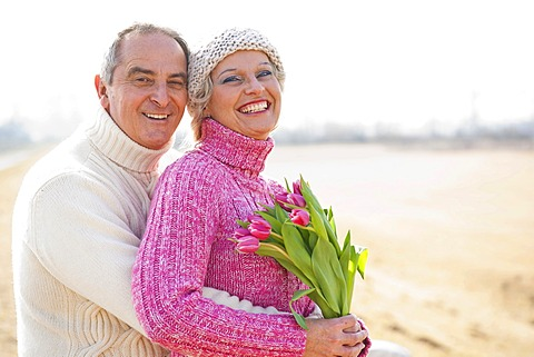 Senior couple holding tulips in their hands