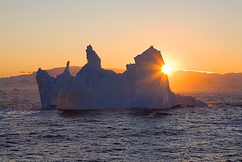 Iceberg at sunrise on the southern polar circle, Antarctica