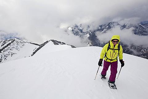 Snowshoe hiker on the summit ridge of Schoenalmjoch in the Karwendel Mountains, Karwendel Mountains, Hinterriß, Tyrol, Austria, Europe