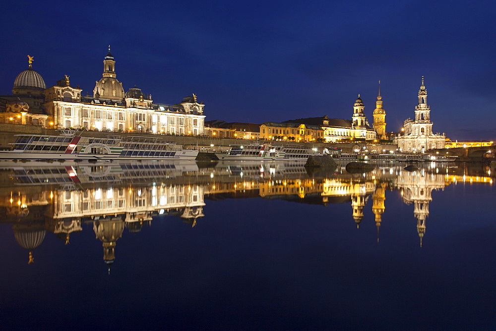 Reflection of the historic city centre of Dresden in the Elbe River at night, Saxony, Germany, Europe