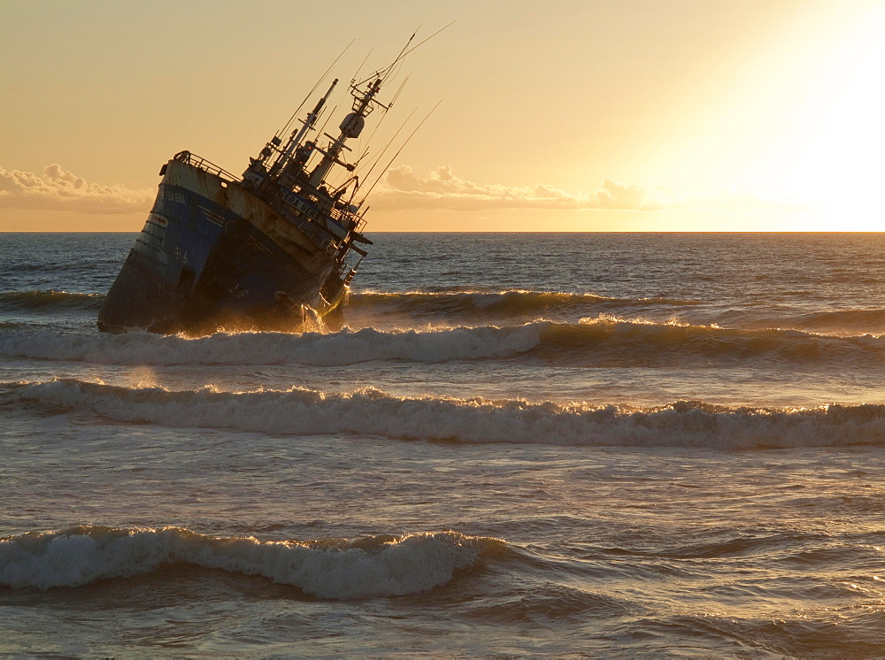 Shipwreck at sunset at Laayoune Plage, Western Sahara, Southwest Morocco, Africa