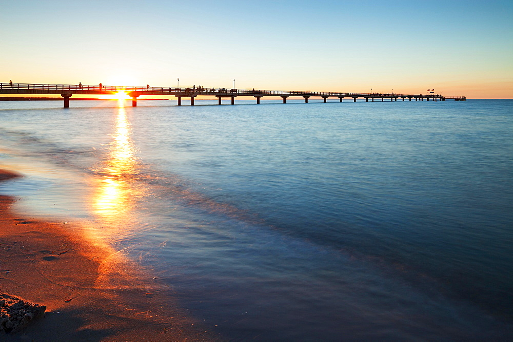 Sunset behind the pier, Baltic Sea, Prerow, Mecklenburg-Western Pomerania, Germany, Europe