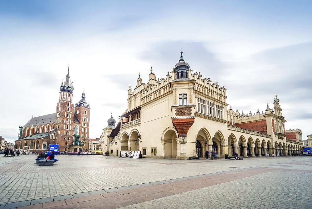 Cloth Hall and St. Mary's Basilica on main Market Square in Krakow, Poland, Europe