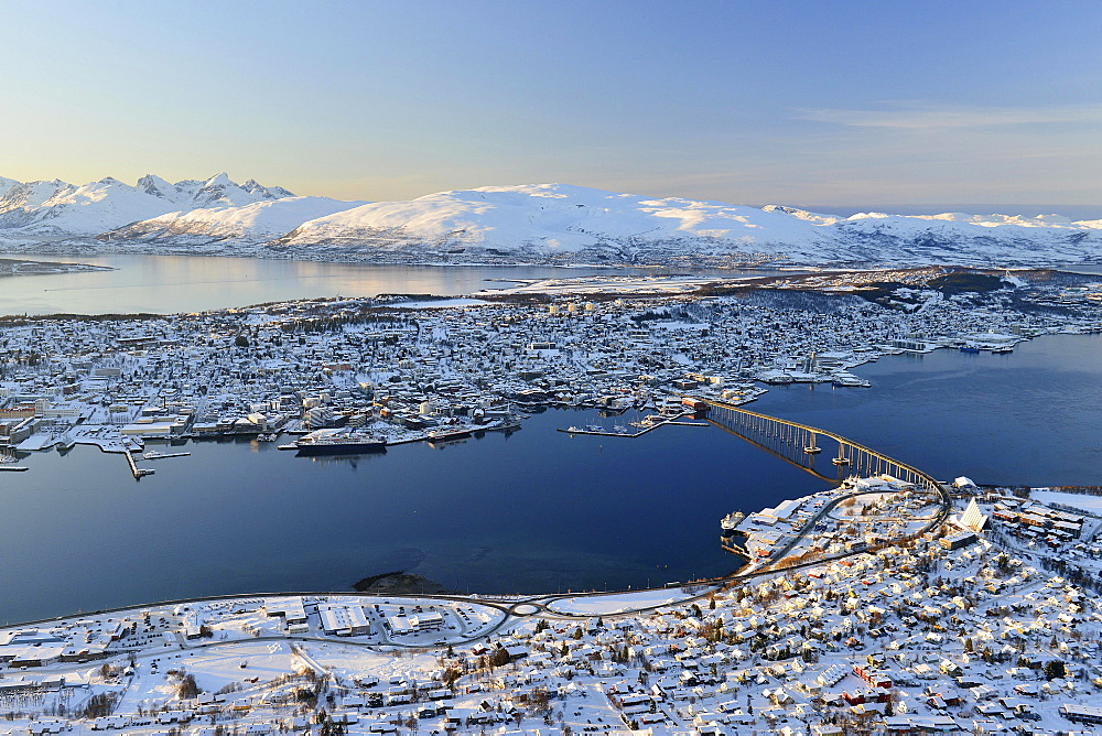 Snowy town with bridge, islands in the North Sea, Tromso, Tromsoysund, Troms, Norway, Europe