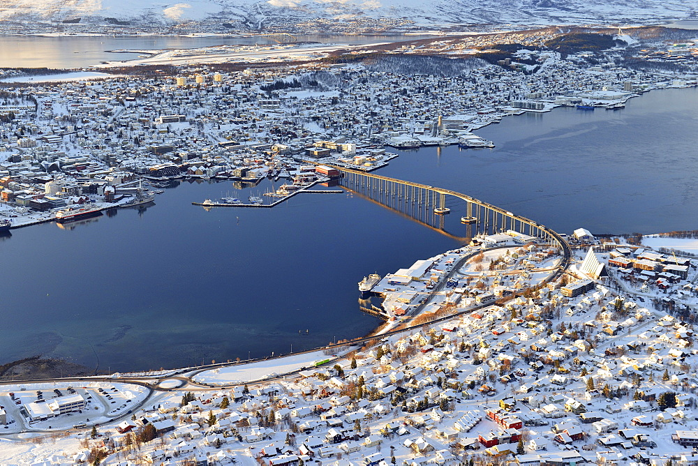 Snowy town with bridge, Tromso, Tromsoysund, Troms, Norway, Europe