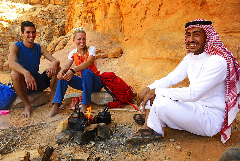 Tourists drink Tea with Bedouin in Wadi Rum, Jordan, Asia