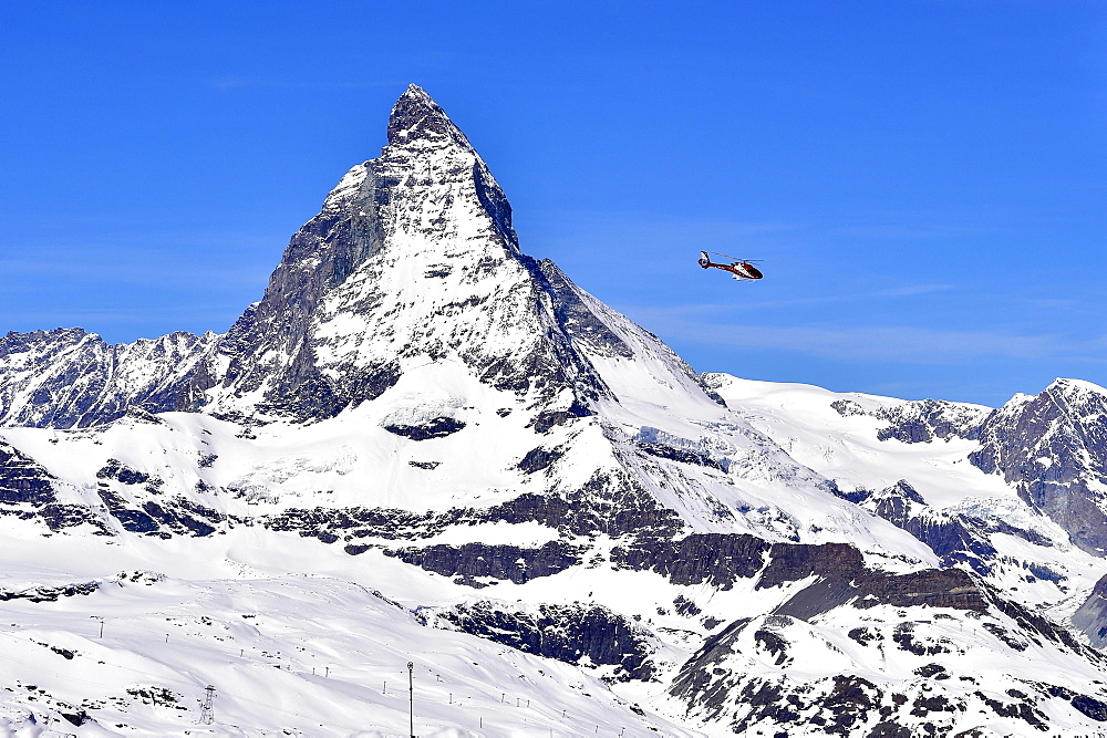 Matterhorn and helicopter from Gornergart, Zermatt, Switzerland, Europe