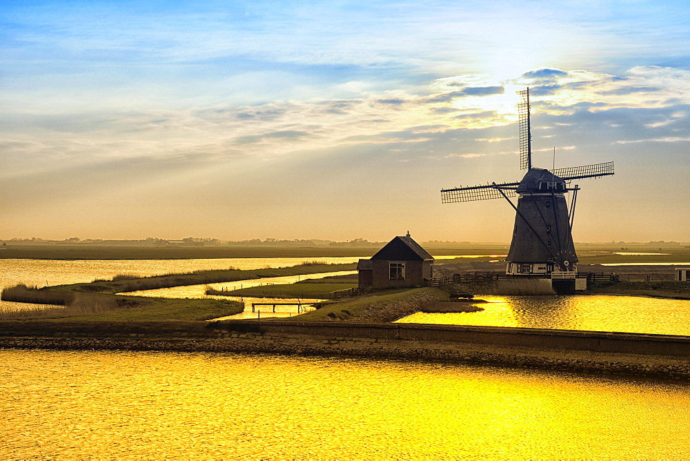 Historic water mill in evening twilight, Texel, North Holland, Netherlands