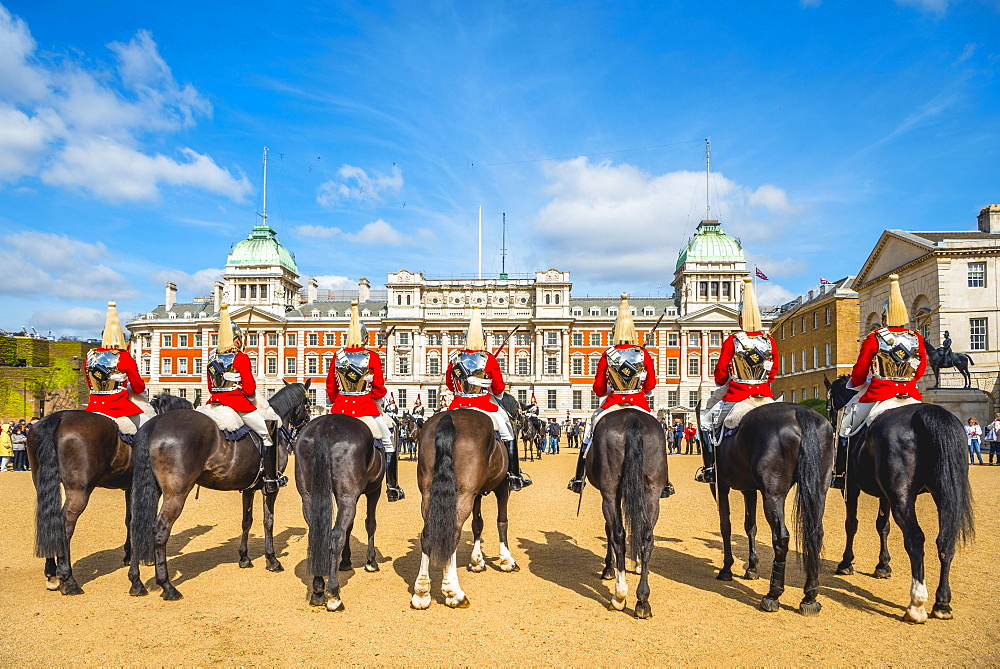 The Royal Guards in red uniform on horses, The Life Guards, Household Cavalry Mounted Regiment, parade ground Horse Guards Parade, Changing of the Guard, Old Admiralty Building, Whitehall, Westminster, London, England, United Kingdom, Europe - 832-379302