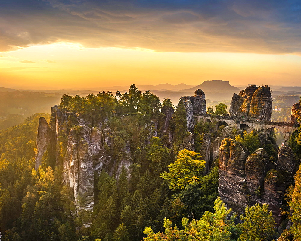 View of Bastei bridge, Bastei at sunrise, in the back the Lilienstein, Elbe Sandstone Mountains, Rathen, National Park Saxon Switzerland, Saxony, Germany, Europe
