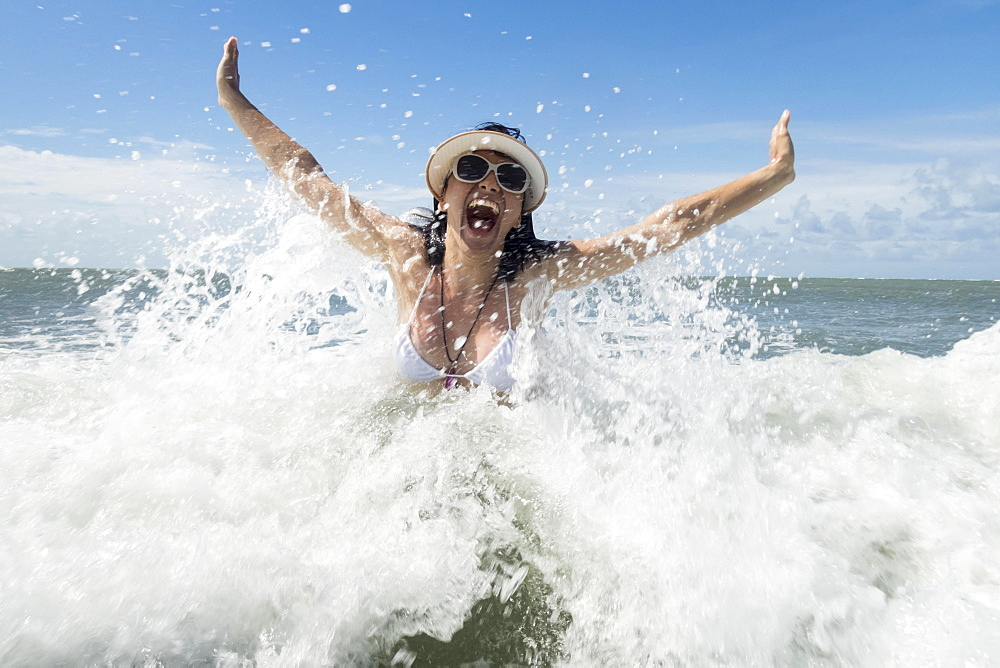 Tourist, woman has fun in the surf of the Atlantic, Natal, Rio Grande do Norte, Brazil, South America