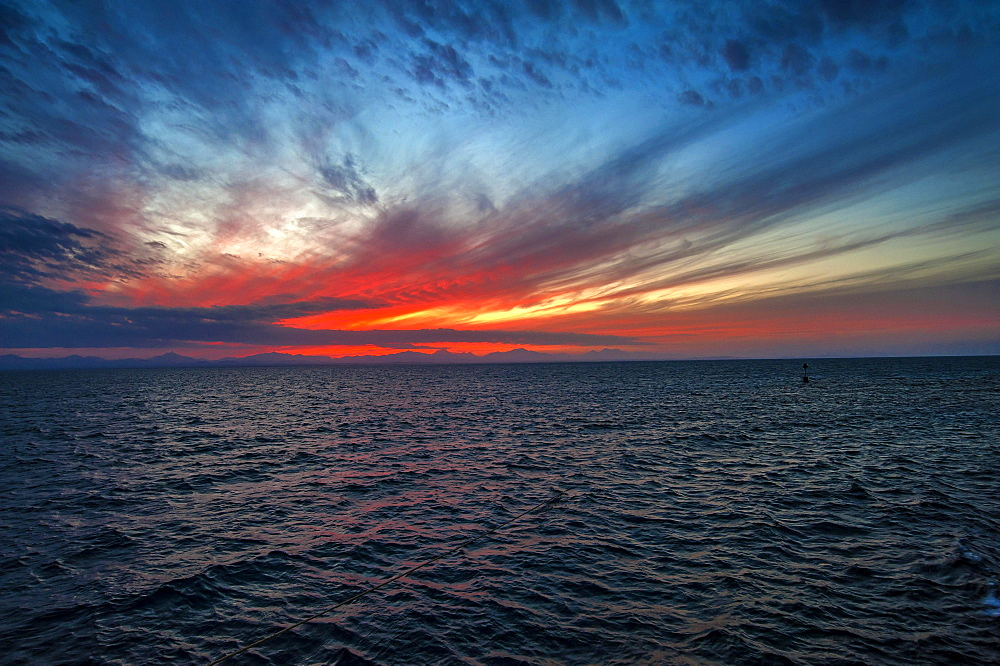 Sunset, ripples in ocean, Red Sea, Egypt, Africa