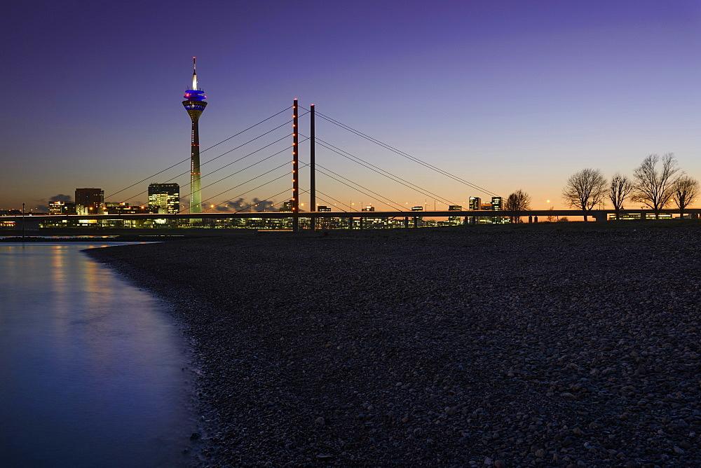City gate, Rhine Tower and Rheinknie Bridge in the evening light, Rhine riverbank, Düsseldorf, North Rhine-Westphalia, Germany, Europe